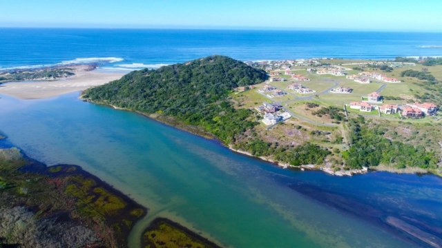 Aerial View of Balugha River Estate along Balura River with a view of the beach